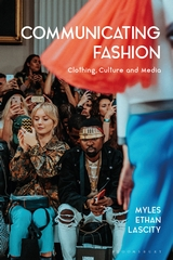 book cover: a woman takes pictures from the front row a fashion show; a red-ruffled garment floats past.