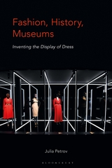 book cover: dresses on display with a grid of white lines in a black rrom.
